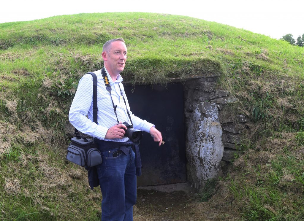 Anthony Murphy guides a Thin Places tour at the Knowth monument